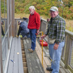 The volunteers were Mark Allen (farthest from camera), John Brothwell (center), and Peter Hickey (nearest camera).